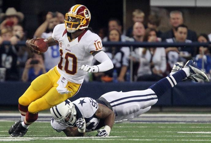washington-quarterback-robert-griffin-iii-scrambles-away-from-the-rush-of-dallas-linebacker-anth
