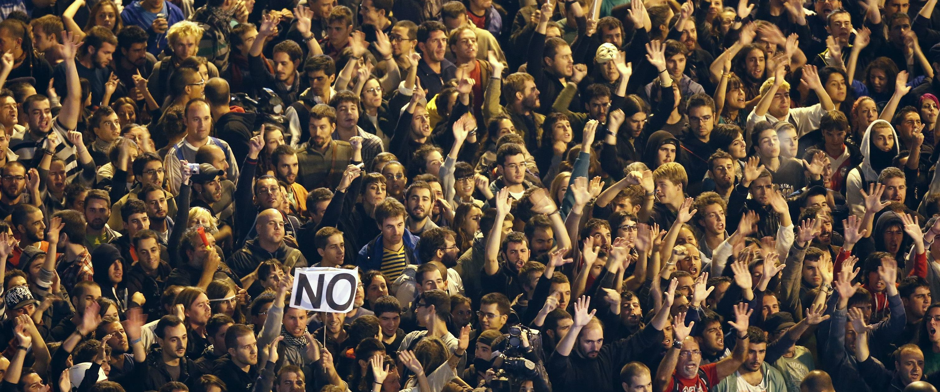 Protesters gather close to Spain's Parliament during demonstration in Madrid